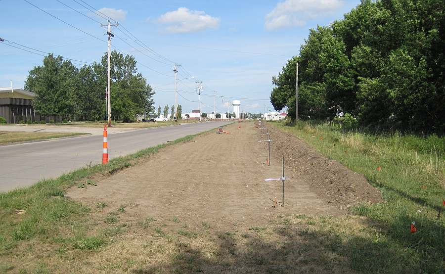 The dirt has been prepared for concrete.  Here the Loop Trail emerges onto Grimes Ave and heads east.