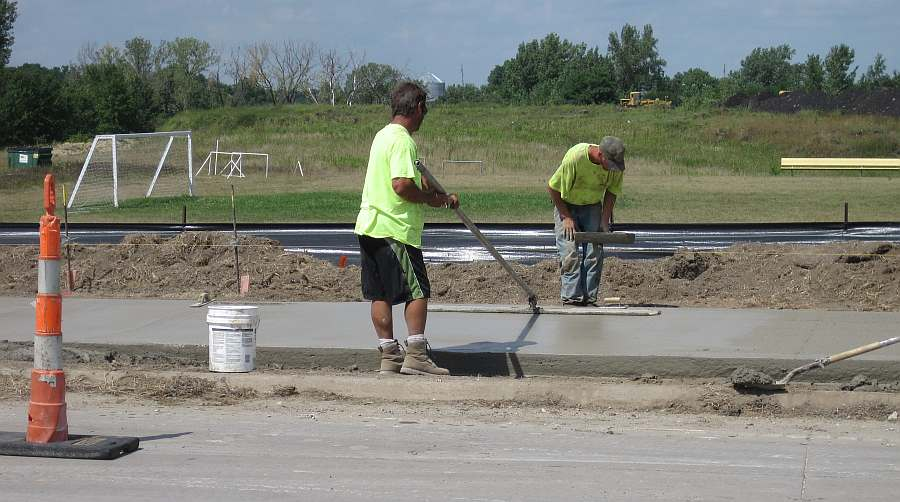 W. Grimes Ave, near the Dexter Soccer Field. Applying finishing touches.