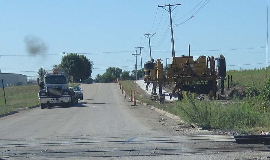 N. 23rd St, looking south from the railroad crossing.  The trail has been paved from Grimes Ave.