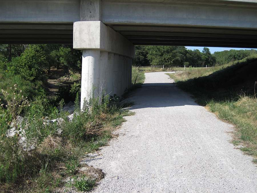The western end of the Whitham Woods segment begins under Business Hwy 34, at the north end of the Iowa DOT Trail.