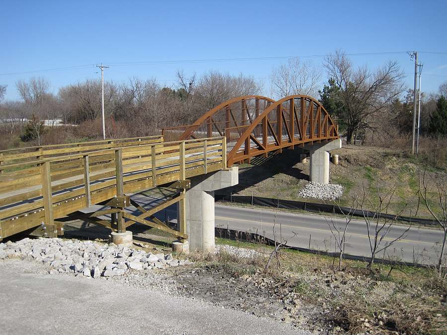 The bridge crosses Iowa State Highway 1, near where the Rock Island Railroad used to cross