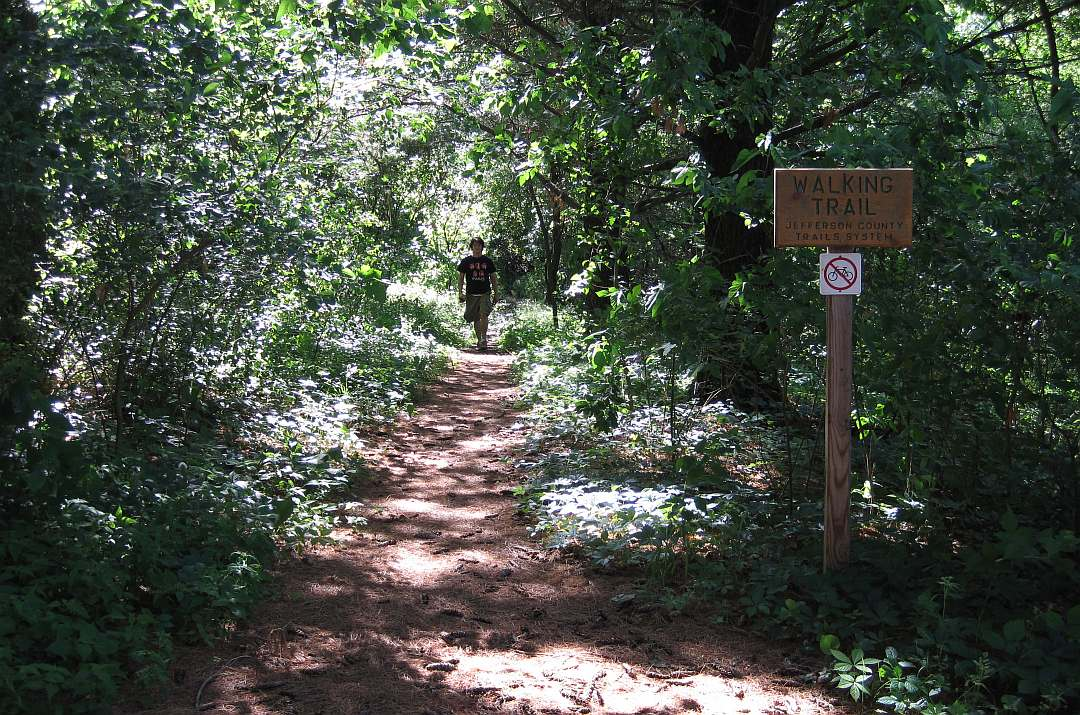 A walker is returning to the Loop Trail.